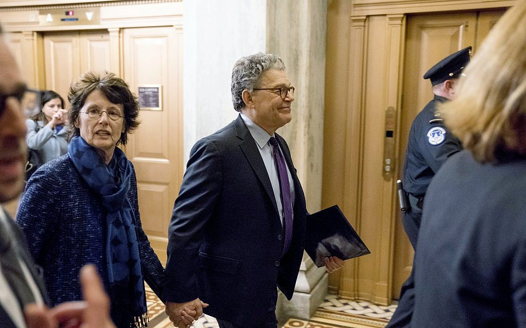 Sen. Al Franken, D-Minn., arrives with his wife Franni Bryson, left, at Capitol Hill in Washington, December 7, 2017.  (AP Photo/Andrew Harnik)