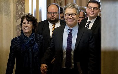 Senator Al Franken, D-Minn., second from right, holds hands with his wife Franni Bryson, left, as he leaves the Capitol after speaking on the Senate floor, December 7, 2017, on Capitol Hill in Washington. (AP Photo/Andrew Harnik)