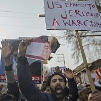 A Kashmiri Muslim shouts slogans and holds a burning photograph of US President Donald Trump during a protest against a decision to recognize Jerusalem as Israel's capital, held in Budgam, southwest of Srinagar, Indian-controlled Kashmir, December 8, 2017. (Dar Yasin/AP)