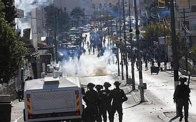 Palestinians clash with Israeli troops during a protest against US President Donald Trump's decision to recognize Jerusalem as the capital of Israel in the West Bank city of Bethlehem, December 8, 2017. (AP Photo/Nasser Shiyoukhi)