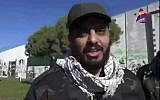 This frame grab from video provided on Dec. 8, 2017, by Asaid Ahl al-Haq's TV station al-Ahd, shows Iraqi militant commander Qais al-Khazali of the Iranian-backed Asaib Ahl al-Haq, or League of the Righteous, speaking in front of a wall that was built by Israel at the Fatima Gate border point in the southern village of Kfar Kila, Lebanon. (Al-Ahd TV station via AP)