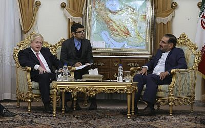 British Foreign Secretary Boris Johnson, left, and Secretary of Iran's Supreme National Security Council Ali Shamkhani, right, with interpreter at centre, during their meeting in Tehran, Iran, December 9, 2017. (AP/Vahid Salemi)