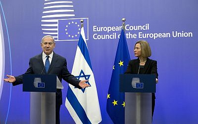 European Union High Representative Federica Mogherini, right, and Prime Minister Benjamin Netanyahu address a media conference at the EU Council building in Brussels on Monday, December 11, 2017. (AP Photo/Virginia Mayo)