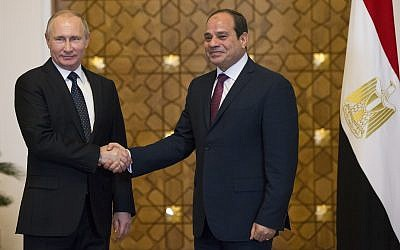 Russian President Vladimir Putin, left, and Egyptian President Abdel-Fattah El-Sissi, shake hands during their meeting in Cairo, Egypt, December 11, 2017. (Alexander Zemlianichenko/ pool photo via AP)