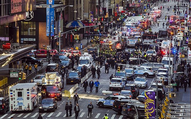 Law enforcement officials work following an explosion near New York's Times Square on December 11, 2017. (Andres Kudacki/AFP)