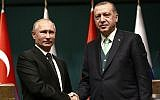 Turkey's President Recep Tayyip Erdogan, right, shakes hands with Russia's President Vladimir Putin, left, following their joint news statement after their meeting at the Presidential Palace in Ankara, on Dec. 11, 2017. (AP Photo/Burhan Ozbilici)