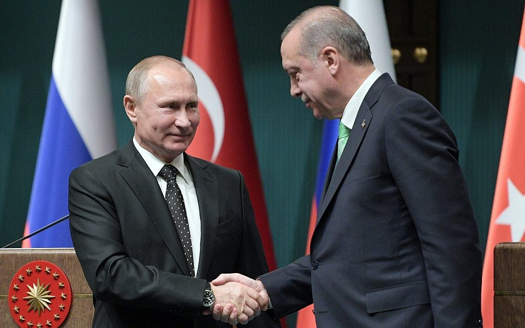 Russia's President Vladimir Putin, left, and Turkey's President Recep Tayyip Erdogan shake hands after a press conference during their meeting in Ankara, Turkey, December 11, 2017. (Alexei Druzhinin/Pool Photo via AP)