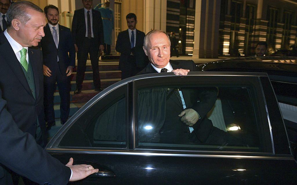 Turkey's President Recep Tayyip Erdogan, left, escorts Russia's President Vladimir Putin, right, as he leaves their meeting at the Presidential Palace in Ankara, December 11, 2017. (Alexei Druzhinin, Sputnik, Kremlin Pool Photo via AP)