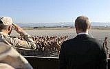 Russian President Vladimir Putin, right, watches the troops marching as he and Syrian President Bashar Assad visit the Hemeimeem air base in Syria, December 11, 2017. (Mikhail Klimentyev, Sputnik, Kremlin Pool Photo via AP)