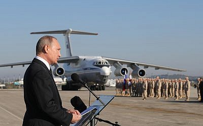Russian President Vladimir Putin addresses the troops at the Hemeimeem air base in Syria, on Monday, December 11, 2017.  (Mikhail Klimentyev, Sputnik, Kremlin Pool Photo via AP)