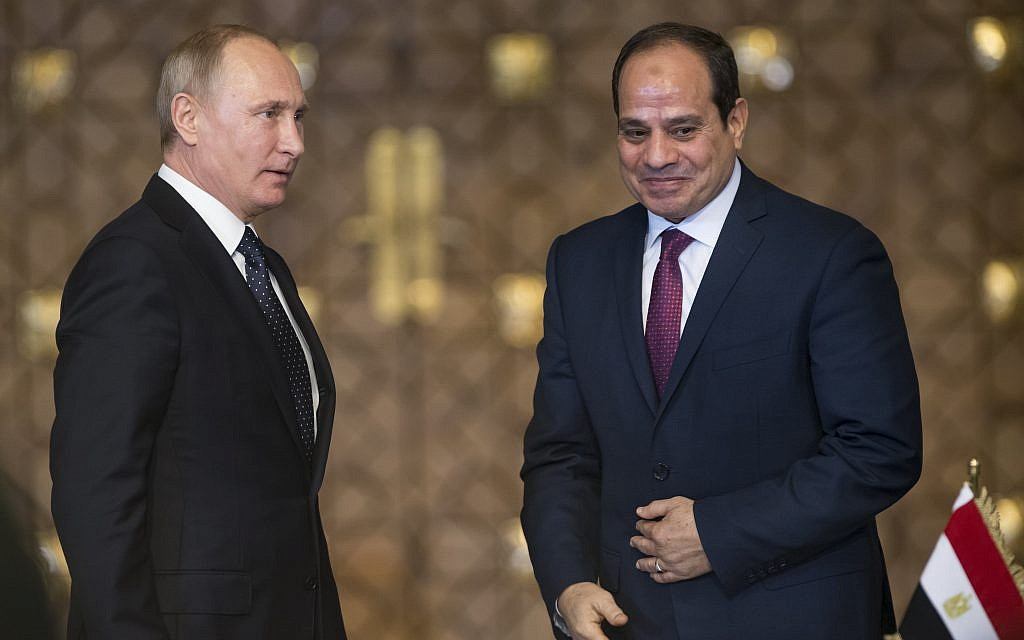 Russian President Vladimir Putin, right, and Egyptian President Abdel-Fattah El-Sissi, leave a news conference following their talks in Cairo, Egypt, December 11, 2017. (AP Photo/Alexander Zemlianichenko, pool)