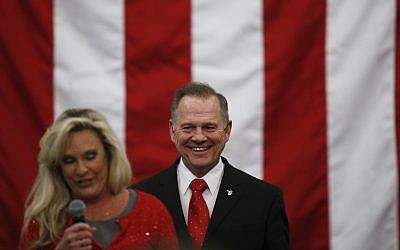 US Senate candidate Roy Moore speaks at a campaign rally with wife Kayla, Monday, Dec. 11, 2017, in Midland City, Ala. (AP Photo/Brynn Anderson)