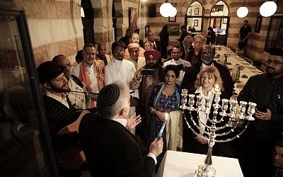 An interfaith group from the Gulf state of Bahrain attends Hannukah candle lighting in Jerusalem, Tuesday, Dec. 12, 2017. (AP Photo/Mahmoud Illean)