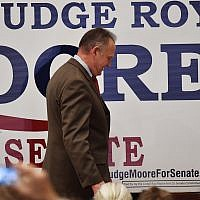 US Senate candidate Roy Moore leaves the stage after speaking at the RSA activity center, Tuesday, Dec. 12, 2017, in Montgomery, Alabama. (AP Photo/Mike Stewart)