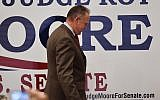 US Senate candidate Roy Moore leaves the stage after speaking at the RSA activity center, in Montgomery, Alabama, December 12, 2017. (Mike Stewart/AP)