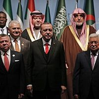 Turkish President Recep Tayyip Erdogan, center, flanked by Jordan's King Abdullah II, left and Palestinian Authority President Mahmoud Abbas, right, poses for photographs with other leaders during a photo-op prior to the opening session of the Organisation of Islamic Cooperation in Istanbul, December 13, 2017. (Lefteris Pitarakis/AP)