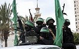 File: Masked operatives from the Izz ad-Din al-Qassam Brigades, the military wing of the Hamas terror group, ride vehicles as they commemorate the 30th anniversary of their group, in Gaza City, December 13, 2017. (AP Photo/Adel Hana)