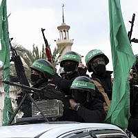 Masked operatives from the Izz ad-Din al-Qassam Brigades, the military wing of the Hamas terror group, ride vehicles as they commemorate the 30th anniversary of their group, in Gaza City, December 13, 2017. (AP Photo/Adel Hana)