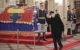 A woman pays her last respects next to the coffin of the late Romanian King Michael at the former royal palace, in Bucharest, Romania, December 13, 2017. (AP Photo/Vadim Ghirda)