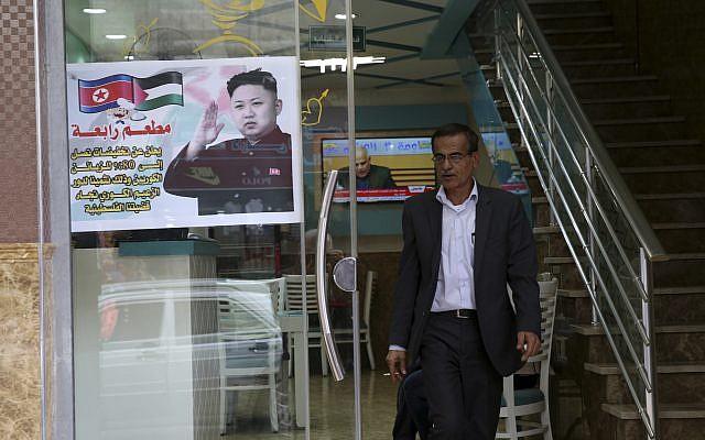 A Palestinian customer walks out of a shawarma restaurant with a poster of North Korean leader Jim Jong in Jebaliya refugee camp, Gaza Strip, December 14, 2017. (AP Photo/Adel Hana)