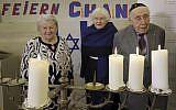 From left, Holocaust survivors Assia Gorban, Marlene Herzberg and Rudolf Rosenberg attend a reception and Hanukkah candle lighting at the Jewish Community Center, in Berlin, Germany, Thursday, Dec. 14, 2017.  (AP Photo/Michael Sohn)