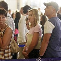In this file photo taken on Nov. 9, 2015, Russian passengers prepare to depart from Sharm el-Sheikh Airport in south Sinai, Egypt. (AP Photo/Ahmed Abd El-Latif)