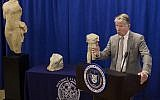 "Manhattan District Attorney Cyrus R. Vance discusses the repatriation of three ancient sculptures during a news conference in New York. The sculptures, from left, the ""Calf Bearer,' the 'Bull's Head,' and the 'Torso,' are being returned to their rightful owners in Lebanon as Vance forms a new antiquities trafficking unit, on December 15, 2017. (AP Photo/Andres Kudacki)"
