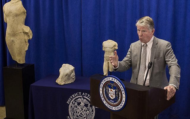 """Manhattan District Attorney Cyrus R. Vance discusses the repatriation of three ancient sculptures during a news conference in New York. The sculptures, from left, the """"Calf Bearer,' the 'Bull's Head,' and the 'Torso,' are being returned to their rightful owners in Lebanon as Vance forms a new antiquities trafficking unit, on December 15, 2017. (AP Photo/Andres Kudacki)"""