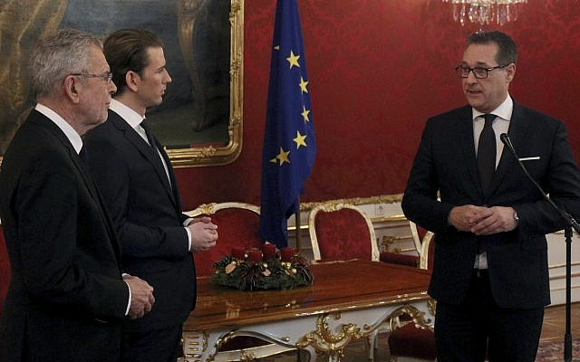 Austrian President Alexander van der Bellen, left, talks with Foreign Minister and leader of the Austrian People's Party, OEVP, Sebastian Kurz, center, and Heinz-Christian Strache,  chairman of the right-wing Freedom Party, FPOE, after the forming of a new coalition government, at the Hofburg palace in Vienna, Austria, Saturday, Dec. 16, 2017. (AP Photo/Ronald Zak)