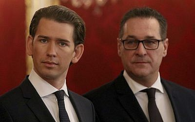 Foreign Minister and leader of the Austrian People's Party, OEVP, Sebastian Kurz, left,  and Heinz-Christian Strache, chairman of the right-wing Freedom Party, FPOE, listen after meeting wiih Austrian President Alexander van der Bellen on forming a new coalition government, at the Hofburg palace in Vienna, Austria, Saturday, Dec. 16, 2017. (AP Photo/Ronald Zak)