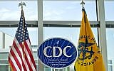 This November 19, 2013, file photo shows a Centers for Disease Control and Prevention logo at the agency's federal headquarters in Atlanta. (AP Photo/David Goldman, File)