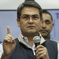 In this December 5, 2017, file photo, Honduran President Juan Orlando Hernandez speaks during a news conference in Tegucigalpa, Honduras. (AP Photo/Fernando Antonio, File)