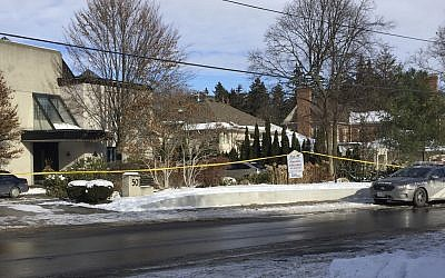 Police tape surrounds the home of billionaire Barry Sherman on Saturday, December 17 2017, in Toronto. (AP Photo/Robert Gillies)