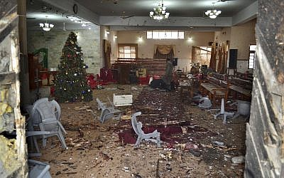 A Pakistani walks in the main hall of a church following a suicide attack in Quetta, Pakistan, December 17, 2017. (Arshad Butt/AP)