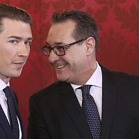 Newly sworn-in Austrian Chancellor Sebastian Kurz, left, and new Vice Chancellor Heinz-Christian Strache talk during the swearing-in ceremony of the new Austrian government in Vienna on December 18, 2017. (AP Photo/ Ronald Zak)
