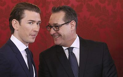 Newly sworn-in Austrian Chancellor Sebastian Kurz, left, and new Vice Chancellor Heinz-Christian Strache, the FPOe's chairman, talk during the swearing-in ceremony of the new Austrian government in Vienna on December 18, 2017. (AP Photo/Ronald Zak)