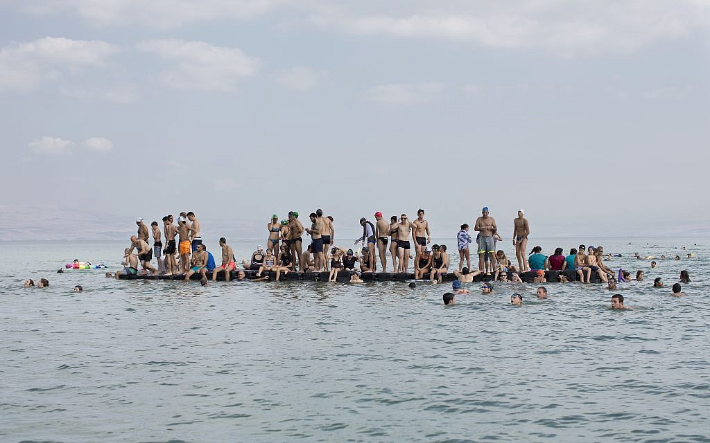 In this Saturday, September 16, 2017, file photo, swimmers participate in the annual Sea of Galilee swim, the oldest and most popular swimming event, near Tiberias, northern Israel. (AP Photo/Oded Balilty)