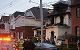 Police and firefighters converge on the scene of a fatal fire in the Sheepshead Bay neighborhood in the Brooklyn borough of New York, Dec. 18, 2017 (AP Photo/Mark Lennihan)