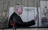 A mural resembling the work of elusive artist Banksy, depicting US President Donald Trump wearing a Jewish skullcap, adorns Israel's West Bank security barrier in Bethlehem, August 4, 2017. (Nasser Nasser/AP)