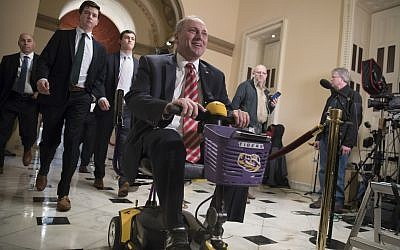House Majority Whip Steve Scalise, a Republican of Louisiana, rides his scooter to the chamber for the final vote on the GOP tax bill, at the Capitol in Washington, December 19, 2017. (AP Photo/J. Scott Applewhite)