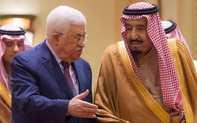 Saudi King Salman, right, receives Palestinian Authority President Mahmoud Abbas after he arrives in Riyadh, Saudi Arabia, December 20, 2017. (Al-Ekhbariya via AP)