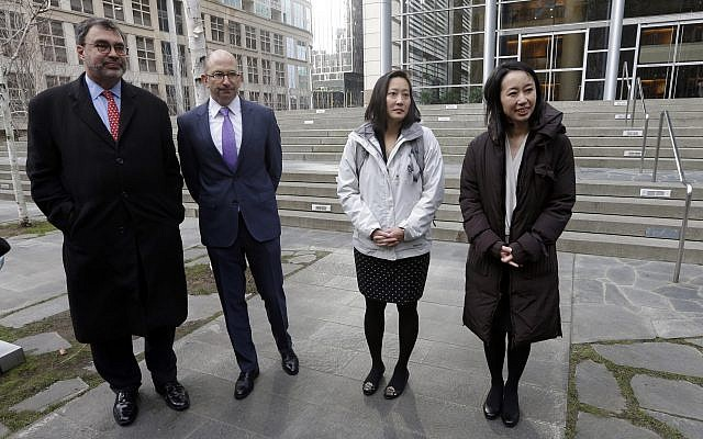 Mariko Hirose, right, a litigation director at the Urban Justice Center, Esther Sung, a staff attorney at the National Immigration Law Center, Rabbi Will Berkowitz, Jewish Family Service of Seattle CEO and Mark Hetfield, president and CEO of HIAS, stand in front of a federal courthouse after speaking with media members there Thursday, Dec. 21, 2017, in Seattle. (AP Photo/Elaine Thompson)
