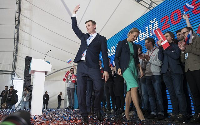 Russian opposition leader Alexei Navalny greets his supporters at a meeting that nominated him for the presidential election race in Moscow, Russia, December 24, 2017. (AP Photo/Pavel Golovkin)