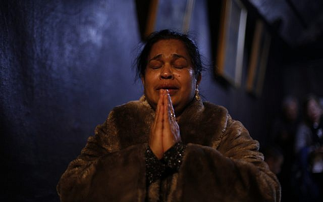 A worshiper prays inside the Church of the Nativity, built atop the site where Christians believe Jesus Christ was born, on Christmas Eve, in the West Bank City of Bethlehem, December 24, 2017. (AP Photo/Majdi Mohammed)