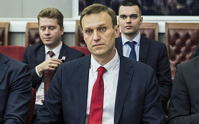 Russian opposition leader Alexei Navalny, sits at the Russia's Central Election commission in Moscow, Russia, Monday, Dec. 25, 2017. (Evgeny Feldman/Navalny Campaign via AP)