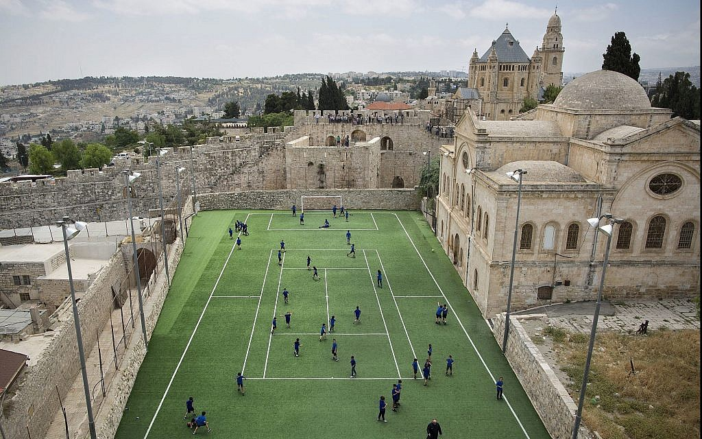 In this photo from May 19, 2017, Armenian school kids play in the soccer field located next to Jerusalem's Old City walls at the Sts. Tarkmanchatz Armenian School of Jerusalem. (AP Photo/Oded Balilty)