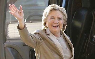 Democratic presidential candidate Hillary Clinton waves as she arrives to vote at her polling place in Chappaqua, New York, November 8, 2016. (AP/Seth Wenig)