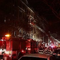 Illustrative image of New York firefighters responding to a building fire in the Bronx borough of New York on December 28, 2017. (AP/Frank Franklin II)