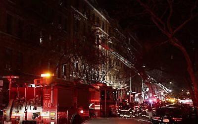 Firefighters respond to a building fire in the Bronx borough of New York on December 28, 2017. (AP/Frank Franklin II)