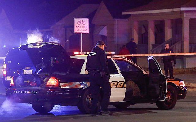 Wichita police investigate a call of a possible hostage situation near the corner of McCormick and Seneca in Wichita, Kansas on December 28, 2017. (Fernando Salazar/The Wichita Eagle via AP)